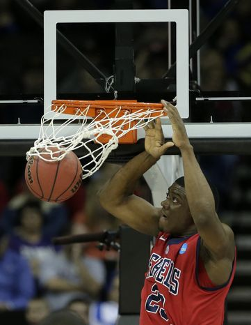Mississippi forward Reginald Buckner (23) dunks the ball during the first half of a second-round game against Wisconsin in the NCAA college basketball tournament Friday, March 22, 2013, in Kansas City, Mo. (AP Photo/Charlie Riedel)
