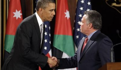 President Obama and Jordan's King Abdullah II shake hands following their joint new conference at the King's Palace in Amman, Jordan, on March 22, 2013. (Associated Press)