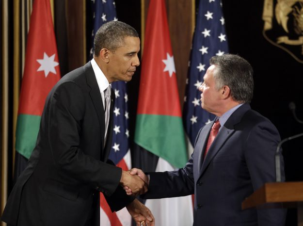President Obama and Jordan King Abdullah II shake hands following their joint new conference at the King's Palace in Amman, Jordan, on March 22, 2013. (Associated Press)