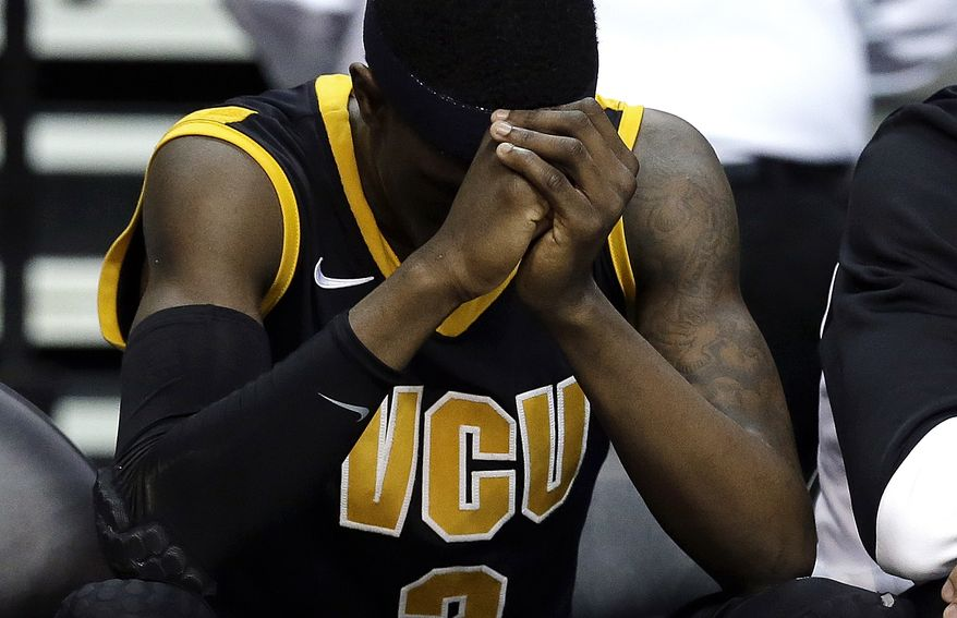 Virginia Commonwealth guard Briante Weber sits on the bench against Michigan in the second half of their third-round game of the NCAA college basketball tournament in Auburn Hills, Mich., Saturday March 23, 2013. Michigan won 78-53. (AP Photo/Paul Sancya)