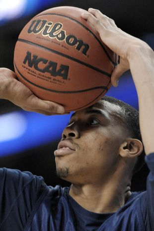 Georgetown's Otto Porter Jr. goes up for a shot during practice for a second-round game of the NCAA men's college basketball tournament, Thursday, March 21, 2013, in Philadelphia.  (AP Photo/Michael Perez)