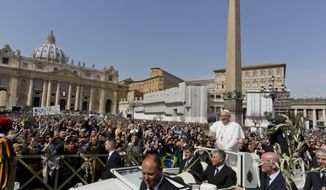 Pope Francis waves to a cheering crowd as he rides in the popemobile through St. Peter's Square at the Vatican on Sunday, March 24, 2013. The pontiff celebrated his first Palm Sunday Mass in St. Peter's Square, encouraging people to be humble and young at heart, as tens of thousands joyfully waved olive branches and palm fronds. (AP Photo/Domenico Stinellis)