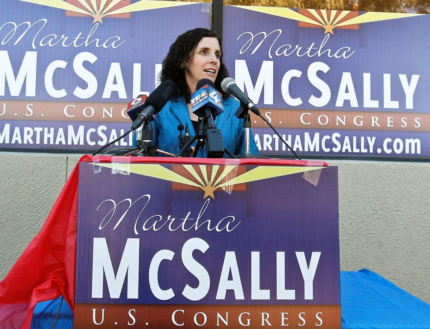 Retired Air Force Lt. Col. Martha McSally is surrounded by signs in her unsuccessful campaign last fall for the U.S. House seat of Rep. Gabrielle Giffords in Arizona. She lost a close race in November to Democrat Ron Barber. (Associated Press)