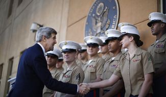** FILE ** U.S. Secretary of State John F. Kerry (left) shakes hands with U.S. Marines based in Baghdad during his visit to the U.S. Embassy in the Iraqi capital on Monday, March 25, 2013. (AP Photo/Jason Reed, Pool)