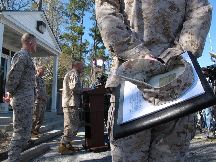 **FILE** Marine Brig. Gen. Jim Lukeman address the media outside the gates of Camp Lejeune, N.C., on March 19, 2013. Seven Marines from the base were killed in a mortar accident in Nevada the previous night. (Associated Press)