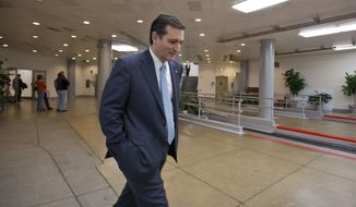 ** FILE ** Sen. Ted Cruz, R-Texas walks through the Capitol complex in Washington, Friday, March 22, 2013. (AP Photo/J. Scott Applewhite)