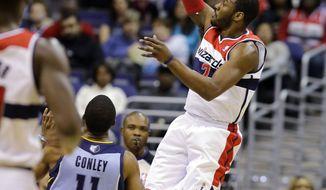 Washington Wizards guard John Wall shoots over Memphis Grizzlies guard Mike Conley (11) in the first half of an NBA game Monday in Washington. (AP Photo/Alex Brandon)