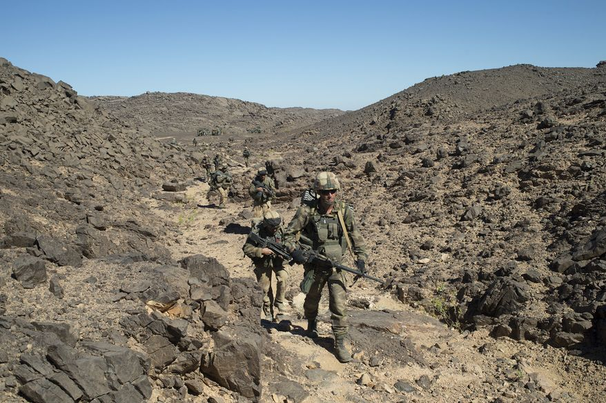 ** FILE ** French soldiers patrol in the Mettatai region in northern Mali on Friday, March 8, 2013. (AP Photo/French Army Communications Audiovisual Office [ECPAD], Arnaud Roine)