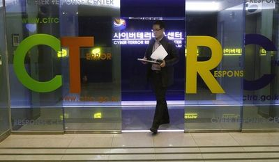 A South Korean police officer from the Digital Forensic Investigation unit leaves the Cyber Terror Response Center at the National Police Agency in Seoul on Friday, March 22, 2013. (AP Photo/Ahn Young-joon)