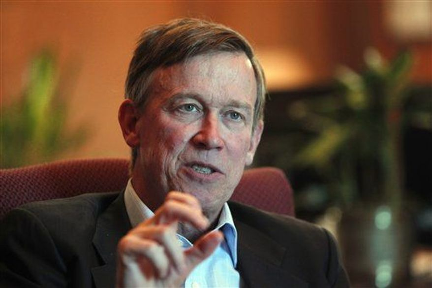 Colorado Gov. John Hickenlooper is pictured during an interview with the Associated Press at his office in the Capitol in Denver, Dec. 12, 2012.