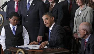 ** FILE ** President Obama signs the Affordable Care Act in 2010 at the White House.