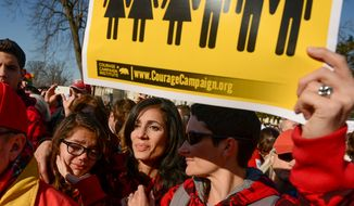 Vanessa Torres (center) and her fiance Rachel Broussard (right) of Hampton, Va., console Vanessa's daughter Gabriela, 12,  as they listen to speakers during a rally for marriage equality outside the Supreme Court in Washington as the justices begin hearing two days of arguments in cases involving gay marriage on March 26, 2013. Torres and Broussard each have two children from previous marriages and are getting married in August. (Andrew Harnik/The Washington Times)