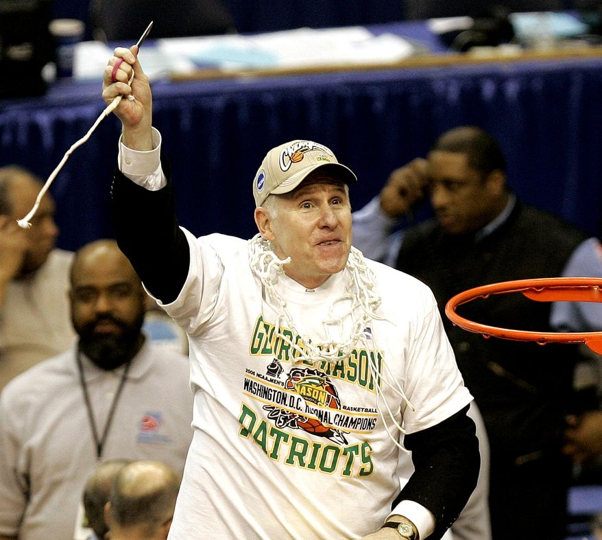 **FILE** George Mason head coach Jim Larranaga finishes cutting the net after beating Connecticut 86-84 in overtime during the fourth round of the NCAA basketball tournament in Washington, Sunday, March 26, 2006. (AP Photo/Susan Walsh)
