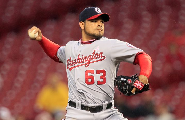 **FILE** Washington Nationals relief pitcher Henry Rodriguez in action against the Cincinnati Reds in a baseball game, Sunday, May 13, 2012 in Cincinnati. (AP Photo/Al Behrman)