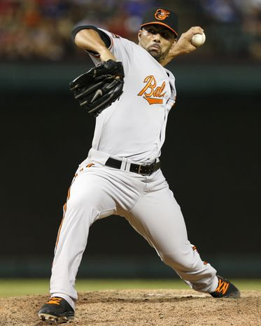 **FILE** Baltimore Orioles relief pitcher J.C. Romero (48) throws to the Texas Rangers during the eighth inning of a baseball game, Monday, Aug. 20, 2012, in Arlington, Texas. The Rangers won 5-1. (AP Photo/Jim Cowsert)