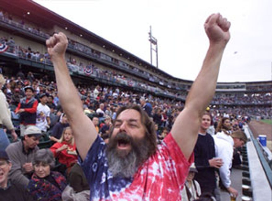 ** FILE ** A fan cheers for minor-league baseball team the Grizzlies. (Associated Press)