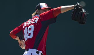 Washington Nationals pitcher Ross Detwiler warms up before the start of an exhibition spring training baseball game against the Atlanta Braves on Wednesday, March 27, 2013, in Viera, Fla. (AP Photo/Evan Vucci)
