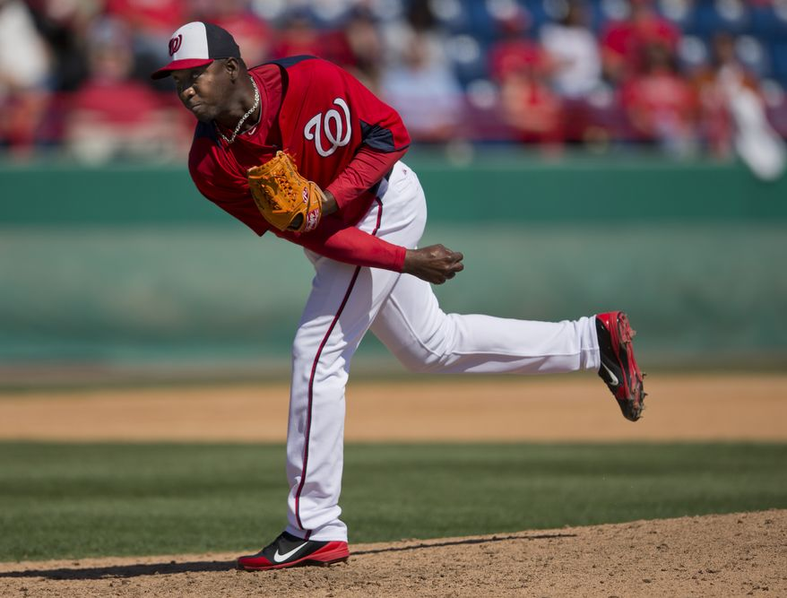 Washington Nationals pitcher Rafael Soriano delivers a pitch during the ninth inning of an exhibition spring training baseball game against the Atlanta Braves on Wednesday, March 27, 2013, in Viera, Fla. (AP Photo/Evan Vucci)