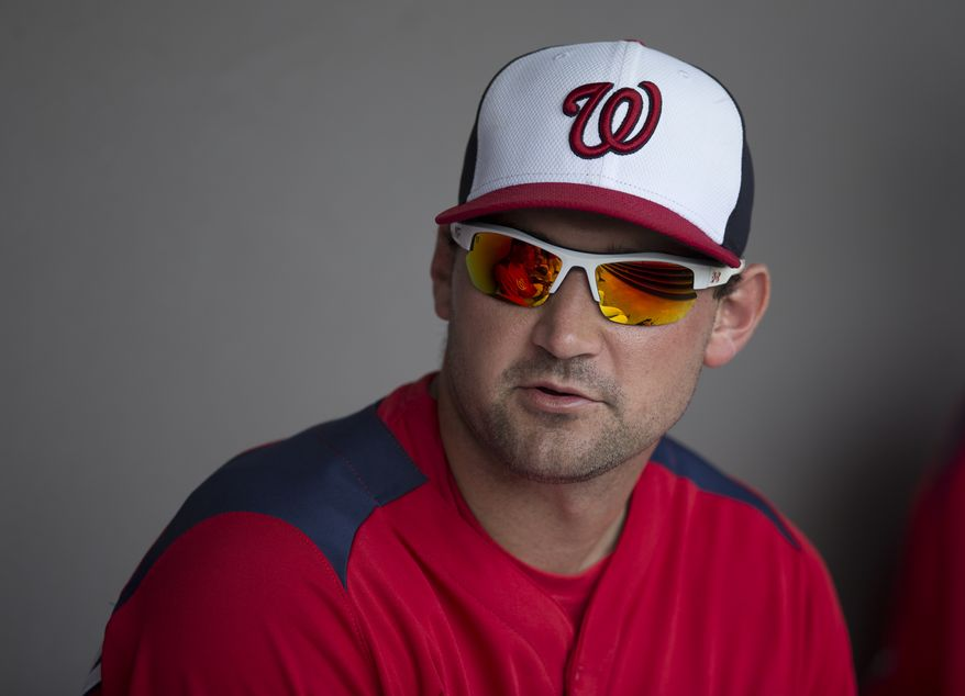 Washington Nationals infielder Ryan Zimmerman sits in the dugout before the start of an exhibition spring training baseball game against the Atlanta Braves on Sunday, March 24, 2013, in Viera, Fla. (AP Photo/Evan Vucci)