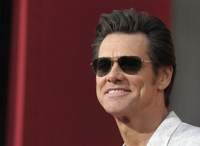 "Actor Jim Carrey arrives at the world premiere of the feature film ""The Incredible Burt Wonderstone"" at the TCL Chinese Theatre in Los Angeles on March 11, 2013. (Dan Steinberg/Invision/Associated Press) **FILE**"