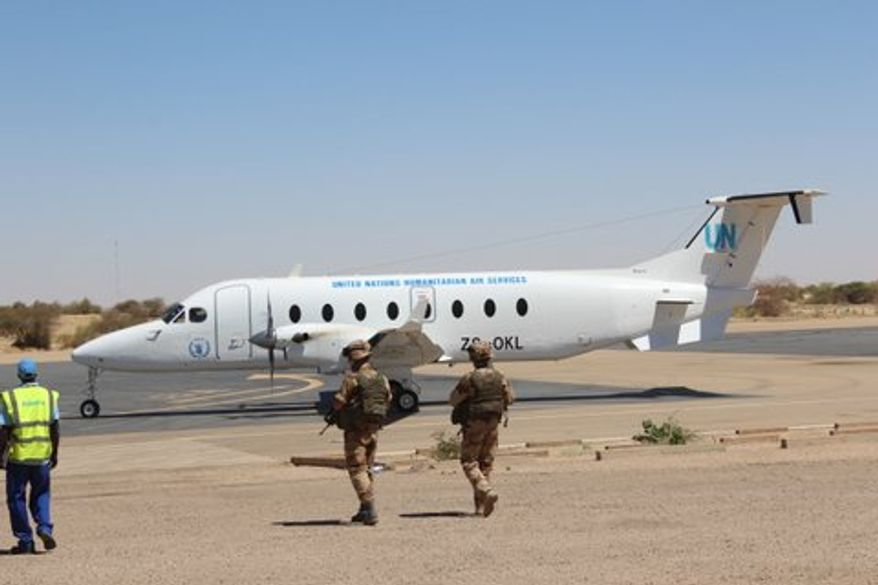 March 22: A U.N. Humanitarian Air Service plane comes to pick up journalists. (Photo by John Price)