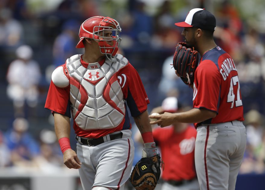 Washington Nationals starting pitcher Gio Gonzalez, right, talks with catcher Wilson Ramos during the third inning of an exhibition spring training baseball game against the New York Mets Saturday, March 23, 2013, in Port St. Lucie, Fla. (AP Photo/Jeff Roberson)