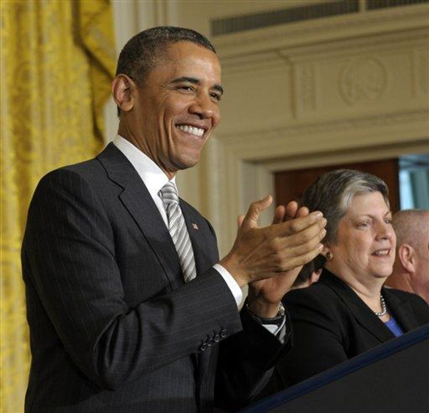 President Obama stands next to Homeland Security Secretary Janet Napolitano during a naturalization ceremony for active duty service members and civilians, Monday, March 25, 2013, in the East Room of the White House in Washington. (AP Photo/Susan Walsh)
