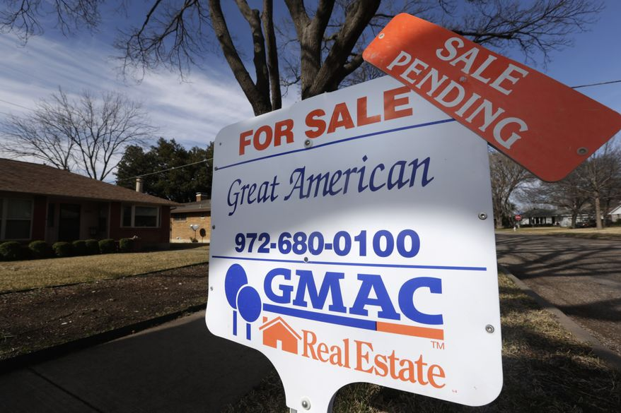 """A """"sale pending"""" announcement sits atop a """"for sale"""" sign in the yard of a home in Richardson, Texas, on Friday, Feb. 22, 2013. (AP Photo/LM Otero)"""