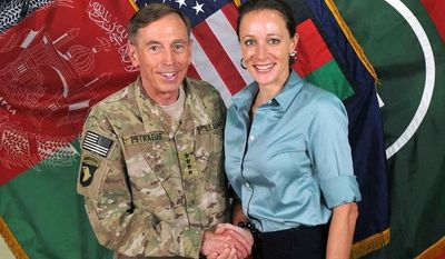 """** FILE ** A photo from July 13, 2011, made available on the International Security Assistance Force's Flickr website shows the former Commander of International Security Assistance Force and U.S. Forces-Afghanistan Gen. Davis Petraeus (left) shaking hands with Paula Broadwell, co-author of  """"All In: The Education of General David Petraeus."""" (Associated Press/ISAF)"""