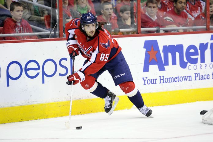 **FILE** Washington Capitals center Mathieu Perreault (85) skates with the puck against the Buffalo Sabres during the second period of an NHL hockey game, Sunday, March 17, 2013, in Washington. (AP Photo/Nick Wass)