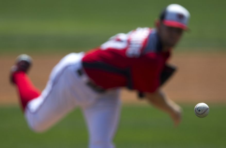 Washington Nationals pitcher Stephen Strasburg delivers a pitch during the second inning of an exhibition spring training baseball game against the Detroit Tigers on Friday, March 22, 2013, in Viera, Fla. (AP Photo/Evan Vucci)