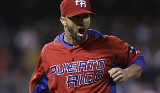Puerto Rico's J.C. Romero against Japan in a semifinal game of the World Baseball Classic in San Francisco, Sunday, March 17, 2013. (AP Photo/Eric Risberg)
