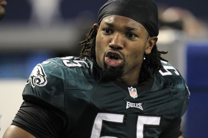 Philadelphia Eagles defensive end Darryl Tapp (55) walks the sideline during the second half of an NFL football game against the Dallas Cowboys Sunday, Dec. 2, 2012 in Arlington, Texas. (AP Photo/LM Otero)