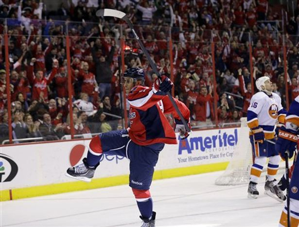Washington Capitals center Mike Ribeiro (9) celebrates his goal in the second period of an NHL hockey game against the New York Islanders on Tuesday, March 26, 2013, in Washington. (AP Photo/Alex Brandon)
