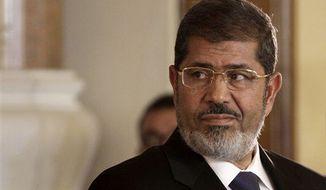 ** FILE ** Deposed Egyptian President Mohammed Morsi (AP Photo/Maya Alleruzzo)