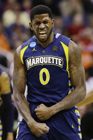 Marquette forward Jamil Wilson (0) reacts to a call during the first half of an East Regional semifinal in the NCAA college basketball tournament against Miami, Thursday, March 28, 2013, in Washington. (AP Photo/Alex Brandon)