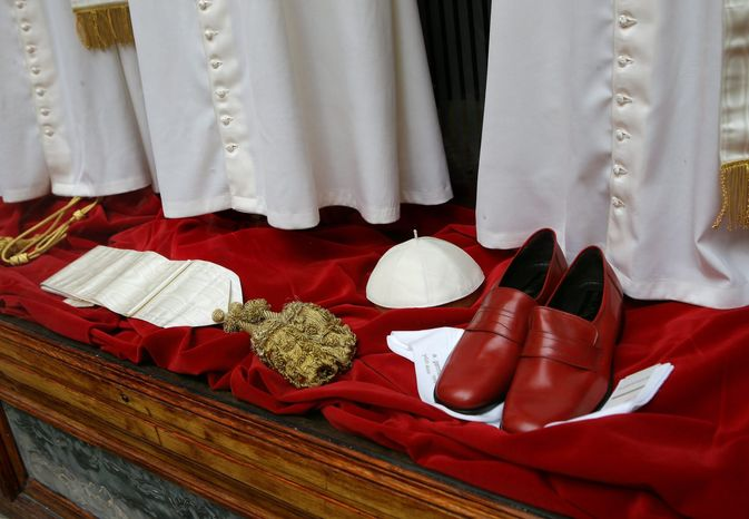 The Gammarelli family, ecclesiastical tailors for centuries, displayed various sizes of papal outfits before Benedict's successor was chosen. The man deemed fit for pope, however, has not worn the red leather loafers.