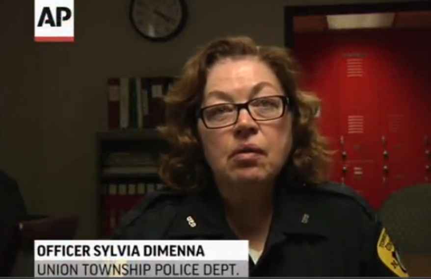 Officer Sylvia Dimenna traveled to the hospital and remained there with the boy, 4, who was found near his dead mother. (Associated Press)