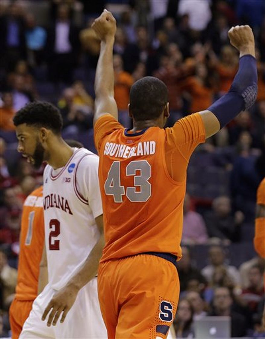 Syracuse forward James Southerland (43) celebrates victory as Indiana forward Christian Watford (2) walks off across the court during the second half of a East Regional semifinal in the NCAA college basketball tournament, Thursday, March 28, 2013 in Washington. Syracuse defeated Indiana 61-50. (AP Photo/Alex Brandon)