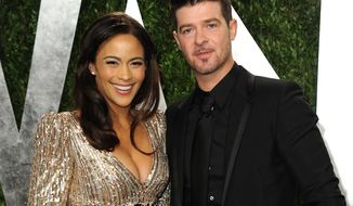 **FILE** Paula Patton and Robin Thicke arrive at the 2013 Vanity Fair Oscars viewing and after-party at the Sunset Plaza Hotel in West Hollywood, Calif., on Feb. 24, 2013. (Jordan Strauss/Invision/Associated Press)