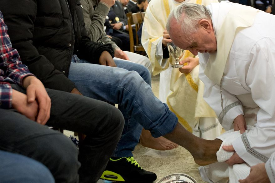 In this photo provided by the Vatican newspaper L'Osservatore Romano, Pope Francis washes the foot of an inmate at the juvenile detention center of Casal del Marmo, Rome, Thursday, March 28, 2013. Francis washed the feet of a dozen inmates at a juvenile detention center in a Holy Thursday ritual that he celebrated for years as archbishop and is continuing now that he is pope. Two of the 12 were young women, an unusual choice given that the rite re-enacts Jesus' washing of the feet of his male disciples. (AP Photo/L'Osservatore Romano, ho)