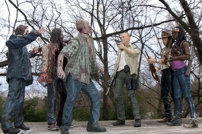 Merle Dixon, Rick Grimes and Michonne face a zombie horde from McFarlane Toys' The Walking Dead: TV Series 3 collection.