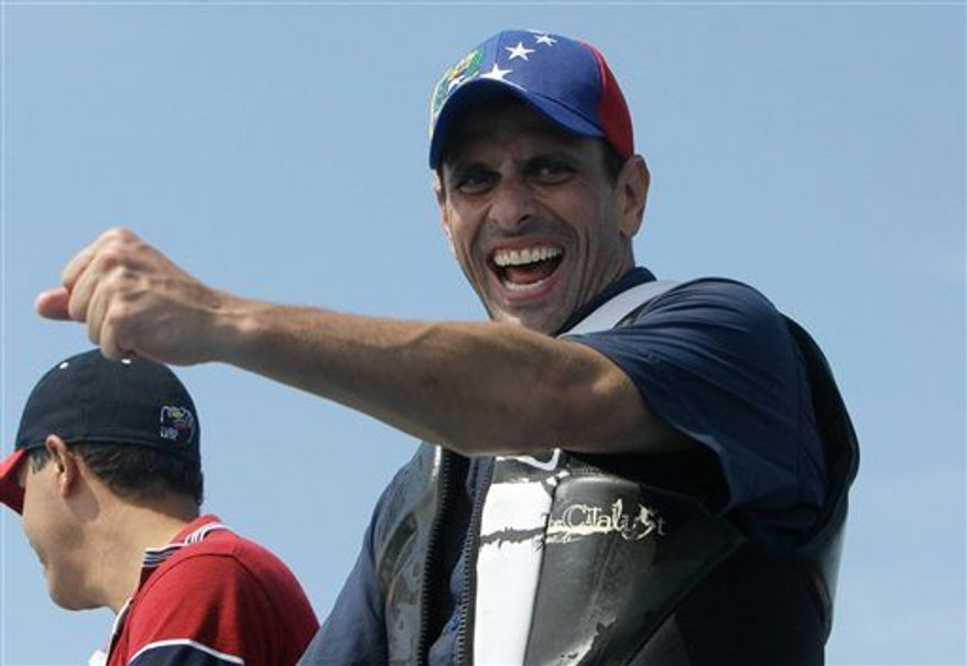 Opposition presidential candidate Henrique Capriles greets vacationing residents during a rally at Morrocoy Keys a resort near Chichiriviche, Venezuela, on Good Friday, March 29, 2013. (Associated Press)