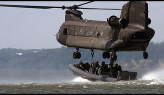 ** FILE ** Navy SEALs conduct training exercises off the coast of Virginia. (Associated Press)