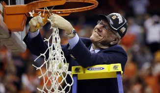 Syracuse head coach Jim Boeheim cuts down the net following their 55-39 win over Marquette in the East Regional final in the NCAA men's college basketball tournament, Saturday, March 30, 2013, in Washington. (AP Photo/Pablo Martinez Monsivais)