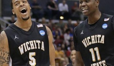 Wichita State guard Demetric Williams (5) celebrates a 3-pointer against Ohio State with teammate Cleanthony Early (11) during the first half of the West Regional final in the NCAA men's college basketball tournament, Saturday, March 30, 2013, in Los Angeles. (AP Photo/Jae C. Hong)