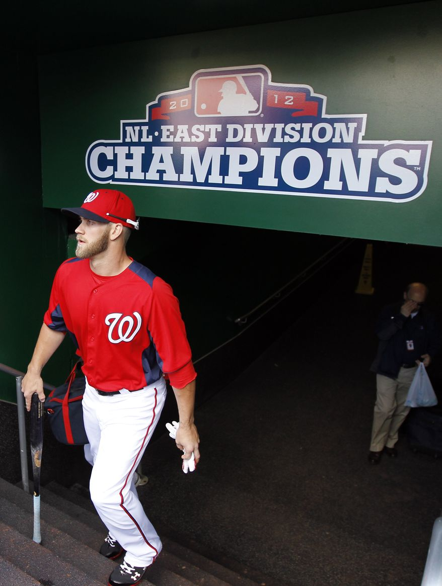 Washington Nationals center fielder Bryce Harper (34) arrives before an exhibition baseball game against the New York Yankees at Nationals Park Friday, March 29, 2013, in Washington. (AP Photo/Alex Brandon)