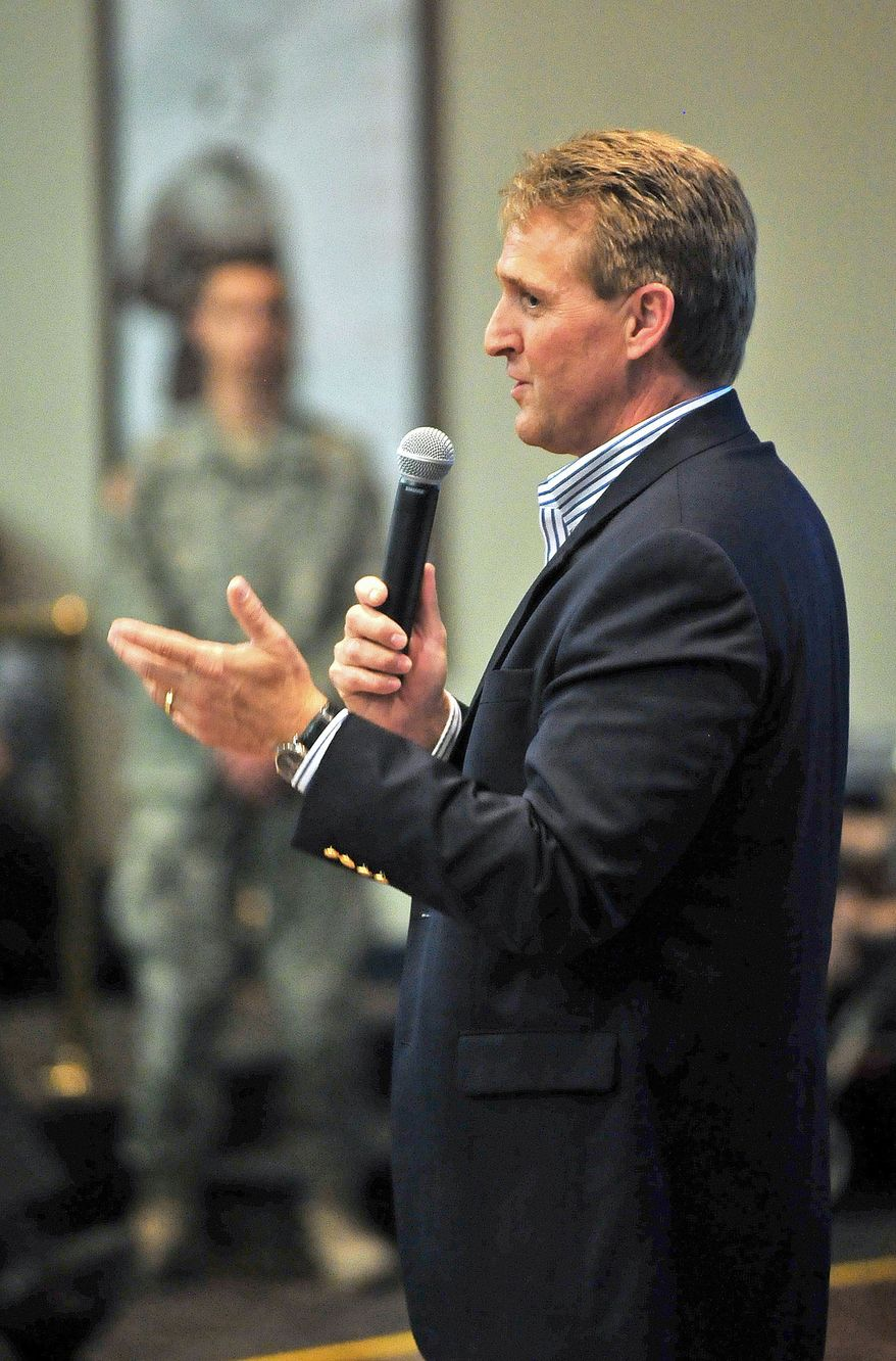 Sen. Jeff Flake, Arizona Republican, answers questions from the crowd about immigration reform, gay marriage and other topics on Thursday, March 28, 2013, during a town-hall-style meeting at Embry-Riddle Aeronautical University in Prescott, Ariz. (AP Photo/The Daily Courier, Matt Hinshaw)