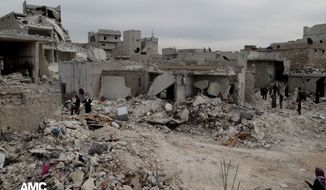 ** FILE ** Syrians inspect houses destroyed by a Syrian forces airstrike in the al-Marjeh neighborhood of Aleppo, Syria, on Tuesday, March 19, 2013, in this citizen journalism image provided by the Aleppo Media Center and  authenticated based on its contents and other AP reporting. (AP Photo/Aleppo Media Center)