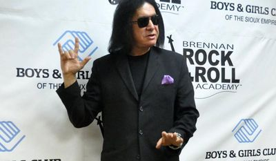 Gene Simmons, the lead singer of the rock band Kiss, makes an unannounced appearance at a fundraiser concert at the Brennan Rock & Roll Academy on Saturday, March 30, 2013, in Sioux Falls, S.D. (AP Photo/Dirk Lammers)